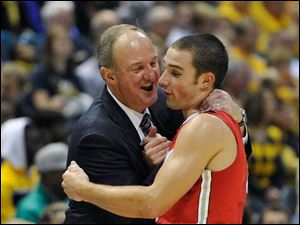 Ohio State head coach Thad Matta, left, smiles as he hugs Aaron Craft during the second half.
