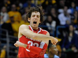 Ohio State's' Amedeo Della Valle celebrates an Ohio State basket against Marquette during the first half.