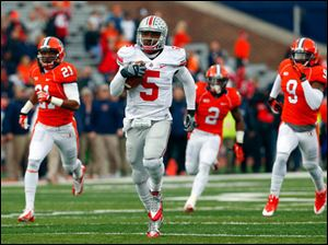 Ohio State quarterback Braxton Miller (5) runs for a 70 yard touchdown as Illinois defensive back Zane Petty (21) defensive back V'Angelo Bentley (2) and defensive back Earnest Thomas III (9) chase him during the first half.