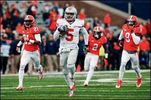 Ohio State quarterback Braxton Miller runs for a 70-yard touchdown against Illinois. He rushed for 184 yards on 16 carries and threw for two touchdowns.