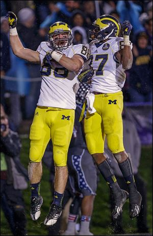 Michigan tight end Jake Butt, left, celebrates with Devin Funchess after scoring a touchdown during the first overtime.