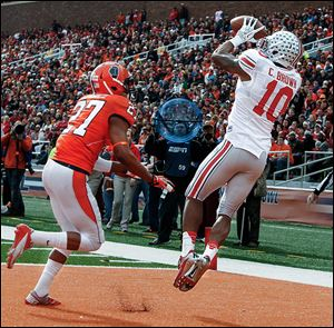 Ohio State wide receiver Corey Brown makes a touchdown catch against Eaton Spence of Illinois.