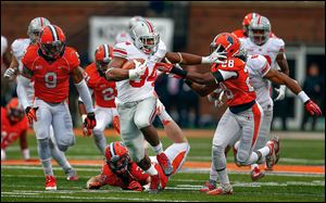 Carlos Hyde stiff-arms Jaylen Dunlap of Illinois on a 51-yard scoring run. Hyde scored five TDs and has 947 yards rushing this season.