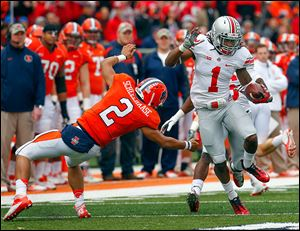 Ohio State cornerback Bradley Roby (1) avoids Illinois quarterback Nathan Scheelhaase (2) as he returns an interception a 63-yards for a touchdown.