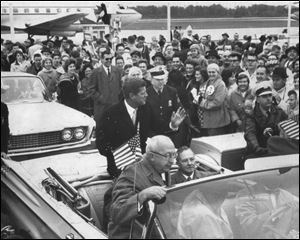 Senator John F. Kennedy, (D-Ma.)waves to onlookers after landing at Toledo Express Airport during the 1960 Presidential campaign.