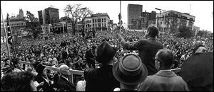 John F. Kennedy speaking from the Adams Street side of the Lucas County Courthouse in downtown Toledo on Nov. 4, 1960, drew a huge and enthusiastic crowd just days before the young senator was elected president.