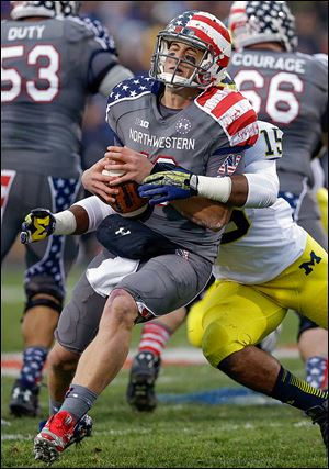 Michigan linebacker James Ross III sacks Northwestern quarterback Trevor Siemian in Saturday's game.