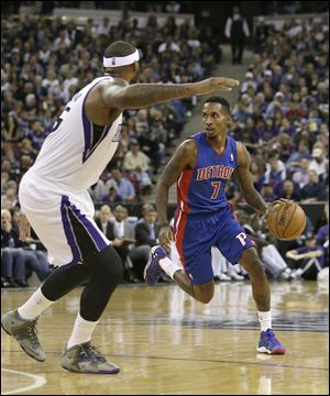 Detroit Pistons guard Brandon Jennings, right, looks to drive against Sacramento Kings  center DeMarcus Cousins during the first quarter of an NBA basketball game in Sacramento, Calif., Friday, Nov. 15, 2013. (AP Photo/Rich Pedroncelli)