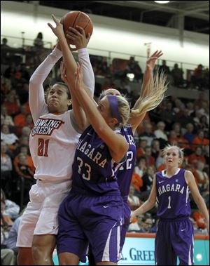 BGSU's Erica Donovan and Niagara's Val McQuade during basketball game at the BGSU Stroh Center in Bowling Green.