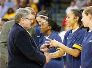 University of Toledo president Dr. Lloyd Jacobs hands a ring to Inma Zanoguera for last season's Mid-American Conference regular season championship before the Rockets' game.