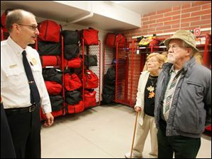Deputy Chief Mike Froelich, left, explains the climate-controlled gear room to former Sylvania Township trustee Bruce Wharram and his wife, Mary, during Sunday's open house.