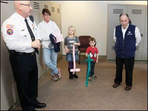 Sylvania Township Fire Department deputy chief Mike Ramm, left, gives a tour of the facility. This room is a persona locker room for the firefighters to maintain a second set on firefighting clothes. Listening are Sandi Konz, second from left, and her grandchildren, siblings Taylor Weldele, 7, and Max Weldele, 4. At right is Dan Gustafson. All live in Sylvania.