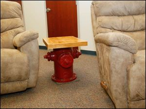 One of the end tables made from a section of the hardwood floor of the previous fire station station.