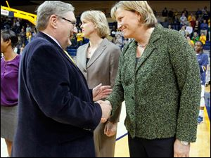 University of Toledo president Dr. Lloyd Jacobs congratulates coach Tricia Cullop during a ceremony before the Rockets' game.