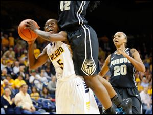 The Rockets' Janelle Reed-Lewis is fouled by Purdue's Camille Redmon.