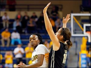 The Rockets' Andola Dortch drives around Purdue's Courtney Moses.