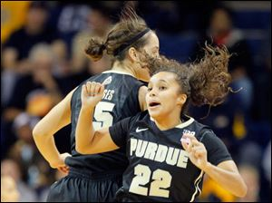 Purdue's Courtney Moses, left, and KK Houser celebrate a basket by Houser during the first half.