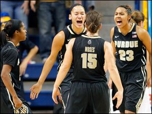 Purdue players, from left, April Wilson, Whitney Bays, Courtney Moses, and Liza Clemons celebrate late in the second half.