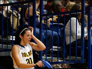 UT's Stephanie Recker wipes a tear as she rides an exercise bike during the second half. Recker was injured on a hard play in the first half.