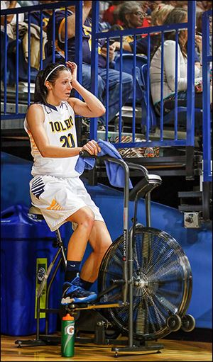 UT's Stephanie Recker pedals  to stay loose. She was injured on a hard play early in the first half.