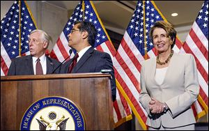 House Minority Leader Nancy Pelosi of California, seen with House Minority Whip Steny Hoyer of Maryland, left, and Rep. Xavier Becerra (D., Calif.), says her party's support for the health-care law remains solid.