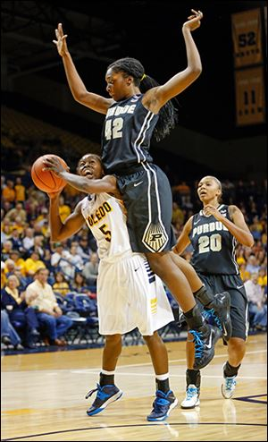 Toledo's Janelle Reed-Lewis is fouled by Purdue's Camille Redmon while taking a shot.