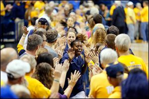 University of Toledo player Janelle Reed-Lewis leads the Rockets out through a tunnel of fans to play No. 18 Purdue University.