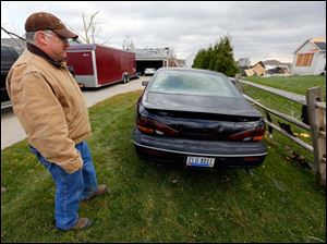 John Kreais was trapped in his car at South Wynn Road home when the storm hit Sunday evening.