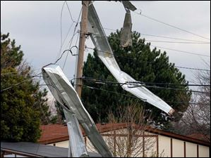 Material from a building is wrapped around a power pole in Perrysburg Township Monday.