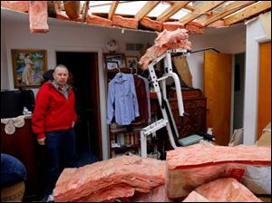 Robert Zeller looks at damage done to a bedroom at his home in Oregon.