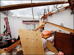 A view of damage done to a bedroom at the home of Robert Zeller in Oregon, Monday.