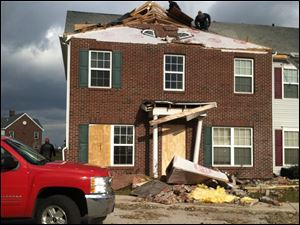 Damage to Owens Lake Commons apartment in Walbrdige were five Owens Community College golfers live.
