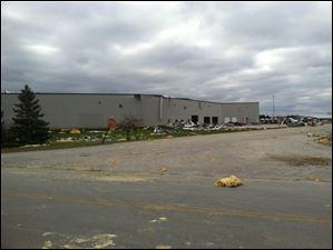 Debris and roof damage of Precision Strip Inc. at Cedar Park industrial park on Ponderosa Road, just next to the corner of 795 and Oregon.