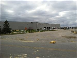 Debris and roof damage of Precision Strip Inc. at Cedar Park industrial park in Perrysburg Township.