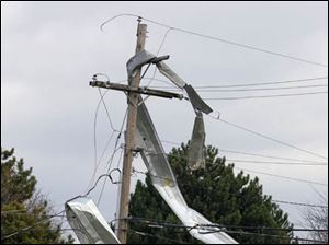 Material from a building is wrapped around a power pole in Perrysburg Township.