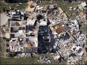 This aerial photo taken Monday shows a home that was destroyed by an EF-4 tornado that hit the town of Washington, Ill.