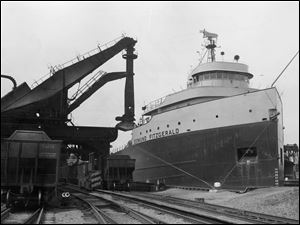 The Edmund Fitzgerald unloads a record 25,172 tons of iron ore at the Toledo Lakefront dock June 21, 1960