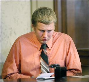 Michael Fay, 18, is eligible for parole after 60 years, Judge Randall Basinger decided.