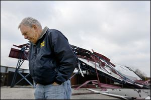Jim Walter, president of the Great Eastern Theatre company, surveys damage to the Sundance Kid Drive-In on Monday in Oregon.