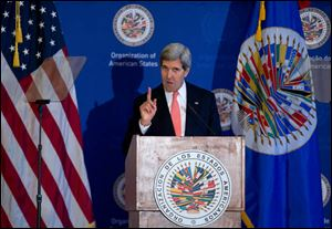 Secretary of State John Kerry gestures as he speaks at the Organization of American States (OAS) in Washington.