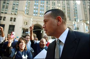 New York Yankees' Alex Rodriguez arrives at the offices of Major League Baseball, in New York in October.