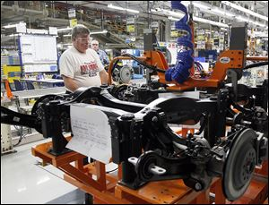 An employee works on the the new Jeep Cherokee line at the Toledo Assembly Complex.