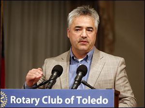 Zach Leroux, manager of the Toledo Assembly Complex, speaks during a meeting of the Rotary Club at the Park Inn in Toledo. He said Chrysler wants to make more than 506,000 vehicles in Toledo in 2014.