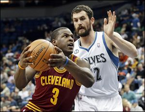 Cleveland's Dion Waiters drives around Minnesota's Kevin Love. Waiters has missed the last two games.