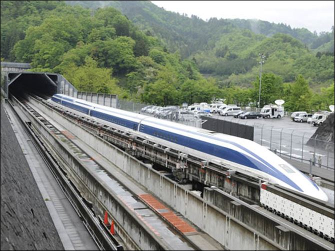 The Maglev (magnetic levitation) train speeds during a test run on the experimental track in Tsuru, 100km west of Tokyo.