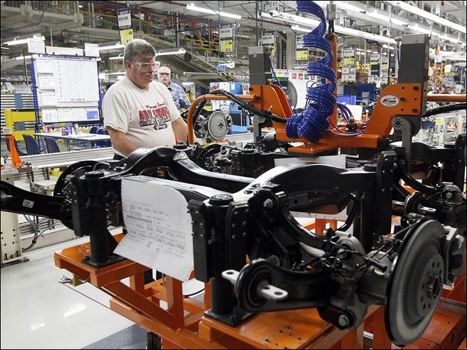 b3jeep An employee works on the the new Jeep Cherokee line at the Toledo Assembly Complex.