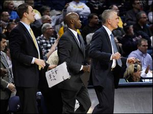 Toledo men's basketball team leaders are, from left, assistant coach Jason Kalsow, director of operations Michael Bennett, and head coach Tod Kowalczyk.