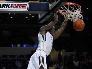 Toledo's Justin Drummond dunks during the ball during the second half of a game against Florida A&M.