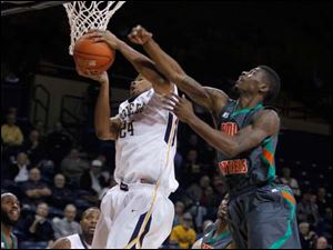 UT's J.D. Weatherspoon grabs a rebound in front of Florida A&M's D'Andre Bullard.