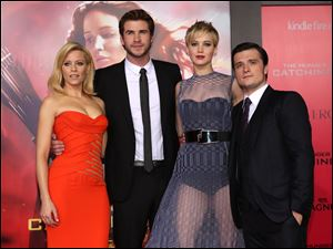 Elizabeth Banks, Liam Hemsworth, Jennifer Lawrence and Josh Hutcherson attend the LA premiere of 'The Hunger Games: Catching Fire' Monday in Los Angeles.
